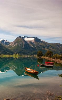 Canoeing on that pristine lake in Hjelle, Norway would be fantastic. - How beautiful!