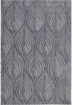 The simple brush designs on this Contour area rug from Nourison's contemporary collection mesmorizes the senses.