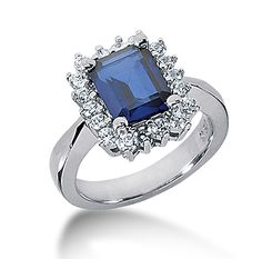 14k White Gold Emerald 9x7 Blue Sapphire and 3/4  Description: True beauty never goes out of fashion as can be said for this absolutely gorgeous Emerald Blue Sapphire and Diamond Ring.   This may not be Lady Di - Princess Diana's ring but wearing this classic  brings back a beauty that never wea away. -> sku=RG2149S -> Price $1925.00