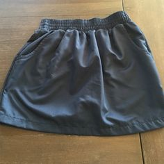 Navy American Apparel Size Small Skirt Silky to the touch Navy American Apparel Size Small skirt. Short skirt with pockets. Classic staple. In great condition. No rips, stains, or damage. Great piece to have for spring and summer. American Apparel Skirts Mini