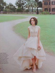 Lovely draped wedding dress with lace hem, pretty beaded cap sleeved top, high low hem.