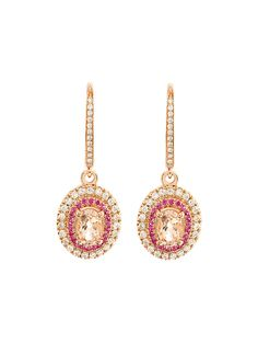 Accented with 0.20 carats of pink sapphire stones and 0.40 carats of white diamonds, these dangling earrings offer glitz and glamour with timeless appeal. Set in 14K pink gold and detailed with morganite oval cut centre stones weighing 0.90 carats, these earrings have a chic and elegant design with secure clasp back closures.