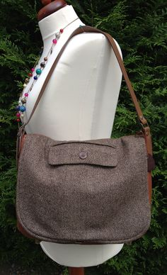 Leather and recycled wool jacket messenger bag