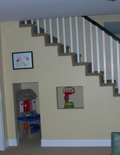 This is the best idea I've ever seen. The kids toys are out of the way, but they are still downstairs so you can keep an eye on them. So doing this.