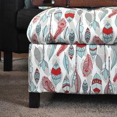 Build and upholster a storage ottoman to add lots of storage and a spot to put your feet up. Bonus- It adds a fun splash of color!
