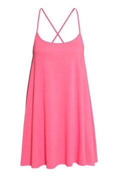 Short, A-line dress in jersey with narrow shoulder straps that cross over at the back.