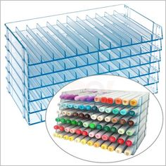 Best copic storage ever!! You buy single trays each holding twelve markers each; you can customize your storage to the size of your collection and the size of your scrap space...and cost less than $7 each...LOVE IT!