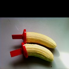 I had a bunch of bananas about to go bad, so I stuck popsicle sticks in them and froze them. Less mess and happy boys.