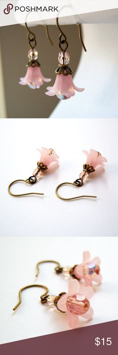 Pink and Bronze Lily Earrings I love the way light pink looks with antique bronze. These feminine earrings have great colors, a vintage feel, and a little bit of sparkle.  Made with pink lucite flowers and faceted Czech glass beads. All wire components are made with permanently colored copper wire.  Earrings measure approximately 1.25 inches. Item may vary slightly from the one shown, and may be smaller than it appears in the detailed close-ups. Jewelry Earrings