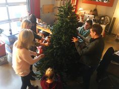 How many members of the dfine team does it take to fluff a Christmas tree?
