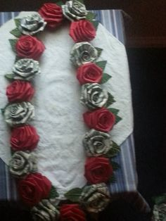 Dollar origami rose made of 4 one dollar bills for graduations or money lei with 5 bill folded twisted roses and ribbon twisted roses mightylinksfo