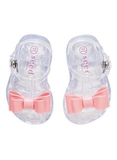 Baby girls bow t/bar sandal. Made from soft PVC these sandals feature snap butto