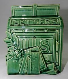 Vintage green McCoy mailbox wall pocket.