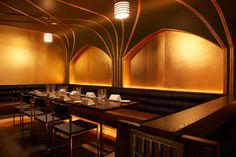 Graphic ceiling treatments add to the Art Deco feel.