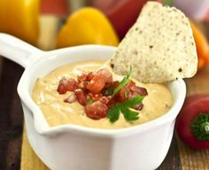 <p>This warm 'cheesy' dip has a mild flavor that can be used to accompany many foods… and also combines very well with salsa to mimic the velveeta/salsa dip from years ago. I make this without nutritional yeast, but if you like it, feel free to add in the nooch!</p>