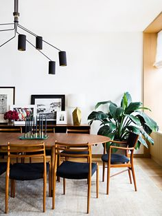 Midcentury modern dining room in black, white and walnut.