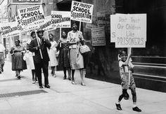The St. Louis Board of Education was picketed by the NAACP after the ...