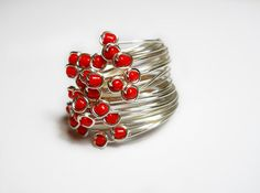 Molecular Ring by Andreea Bololoi, Romania - 0.6 mm silver wire, seed beads