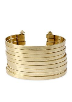 This elegant cuff bracelet features multiple rows of gold-tone wire. It's the perfect piece to complete your look.