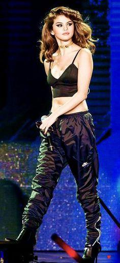 On stage - with my black sweats, black VS sports bra & boots.