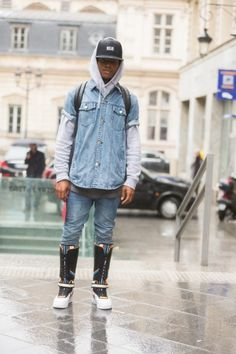 A man in a NikeAir cap and Nike x Riccardo Tisci Air Force 1 sneaker boots attends the Viktor Rolf show on Day 4 of Paris Haute Couture Fashion Week...
