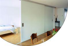 Full height, sliding doors.  www.modernmillworkinnovations.com    EKU AG - EKU-DIVIDO 100 H