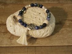 SODALITE     Semi Precious stone stretch bracelet comes with a vial of essential oils and placed in a decorative tin with a card describing the Stone & Essential oils.This bracelet comes with a tassel !