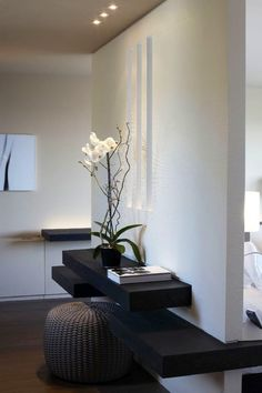 White orchids in the living room? Easy to maintain and adds to the zen feel