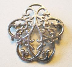 Sterling IC Interestingly Designed Small Pin - Art Nouveau or Celtic Styling - vintage gift. $18.00, via Etsy.