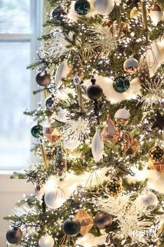 a black and gold christmas tree with white lights from Inspired by Charm