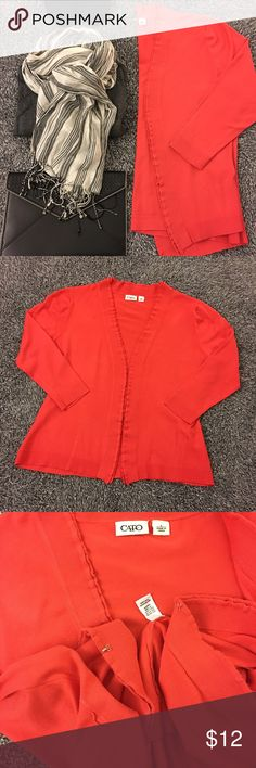 Bold coral cardigan - add a lil' color to ur life! Hardly worn. Great shape and SF. Has belt loops so you can add a belt of your choice. Can be clasped shut in the front. (See pictures for details.) Cute layered/ruffle like detail on the front. Prefect for layering. Bust measures 21 inches laid flat. Hips are about 20.5. Length is 23. Sleeve length is 19 inches from shoulder seam to cuff hem. Orange/red/coral color - pics are pretty accurate. Questions? Ask! Offers/bundles welcomed! No…