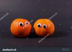 Two mandarin oranges with googly eyes