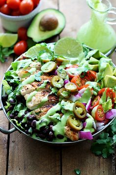 Traditional tacos salads with a twist- chock full of veggies, topped with grilled chicken, and drizzled with the most amazing spicy cilantro lime dressing!