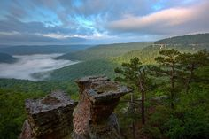 Sunrise at the Tea Table Rocks on Home Valley Bluff. The fog rising is from the Big Piney River below.  © copyright by Tom Kennon