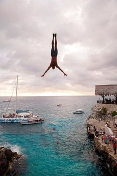 Diving from a platform at Rick's Café in Negril. (Photo: Robert Rausch for The New York Times)