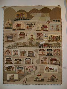 Reiko Kato appliqué quilt - village with a train