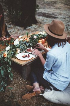 Find table garland decorating ideas and inspiration for warm weather entertaining, indoor and outdoor tables, and centerpiece alternatives on domino. Use a garland on your table instead of a centerpiece.