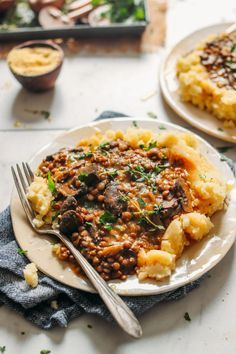 Close up photo of a plate of gluten-free and plant-based Lentil Mushroom Stew Over Mashed Potatoes
