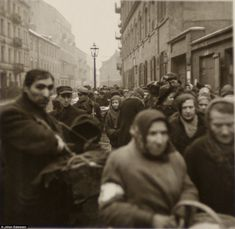 Ghetto: A picture of Warsaw ghetto. The woman in the centre of the image, looking at the camera, may have been Horst's mother Charlotte, Philippe has speculated