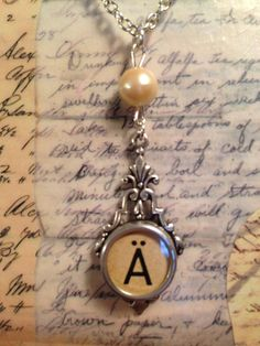 "Vintage German Typewriter Key Letter A on an 18"" silver chain accented with a pearl.  This necklace is a part of LoveEuniceDesigns, $22.00"