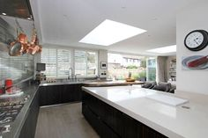 Very large open plan kitchen with a large breakfast bar, comfy sitting area and bi-fold doors out to the garden and pool: Location Partnership