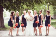 Navy bridesmaid dresses with yellow flowers and coral shoes!