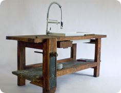 An old carpenter bench, a clamp and a sink