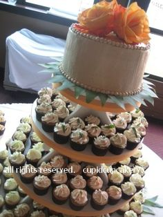 maple buttercream frosting on 8 inch round cutting cake; real orange roses on top and bay leaves on the bottom