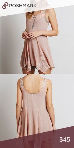FREE PEOPLE BEADS FOR DAYS NWT TUNIC Sheer swing slip dress with embroidery and bead embellishments on the straps and hem. Uneven hem. 100% Polyester. Machine Wash Cold. Import. Free People Dresses Mini