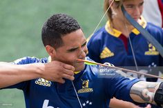 Highlanders` Aaron Smith tries his hand at archery during the New Zealand Super Rugby season launch on February 2015 in Auckland, New Zealand. Get premium, high resolution news photos at Getty Images Aaron Smith, Super Rugby, Highlanders, His Hands, Archery, Baseball Cards, News, Sports, Image