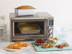 Toaster ovens aren't just good for making toast. Food Network shares 13 creative ways to put your toaster oven to good use. Toaster Oven Cooking, Convection Oven Cooking, Toaster Oven Recipes, Toaster Ovens, Microwave Oven, Food Network Recipes, Cooking Recipes, Cooking Tips, Easy Recipes