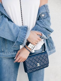 Oversized Denim Jacket with a simple white tee and jeans. Accessories: Chanel Wallet on a chain, IceLink jewelry | Fall fashion | Minimal Outfit |  www.suzysogoyan.com