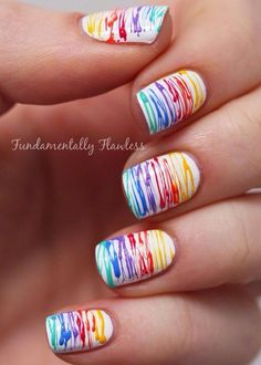 White nails with various rainbow drip or string designs Gay Pride Nails