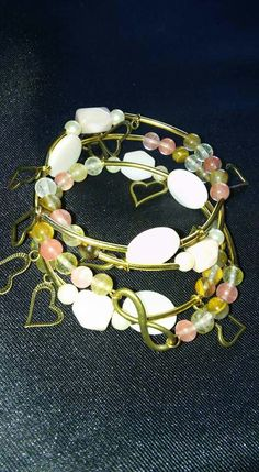 Handmade memory wire wrap bracelet with mother of pearl, shells, bronze hearts and infinity sign, watermelon tourmaline and opalite https://m.facebook.com/LaceOfHeartsJewellery